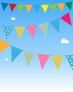 Bunting flags festive hanging on blue sky Stock Photo