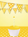 Bunting and yellow birthday cupcake Royalty Free Stock Image