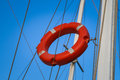 Buoy attached by ropes to the yacht s pole Stock Photo