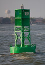 Buoy green in foreground provides guidance Stock Photo