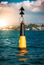 Buoy with red light in sea yellow Stock Photography