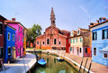 Burano canals colorful buildings and leaning bell tower in venice italy Royalty Free Stock Photos
