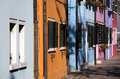 Burano houses colored facades bright of in the street of venetian island Stock Images