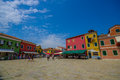 BURANO, ITALY - JUNE 14, 2015: Big square at Burano, little houses of colors and turists everywhere Royalty Free Stock Photo