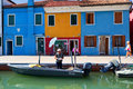 BURANO, ITALY - SEPTEMBER 17, 2015: Venice landmark, Burano island canal, colorful houses and boats, Italy. Royalty Free Stock Photo