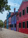 Burano street lined with bright colorful homes Royalty Free Stock Photo