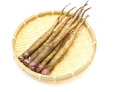 Burdock on a bamboo colander pictured group of in white background Stock Images
