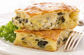 Burek with feta and spinach as closeup on a white plate Stock Photo