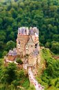 Burg eltz castle nestled in the hills above the moselle river germany view with tilt shift effect Stock Photo