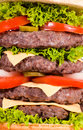 Burger background big beef hamburger with vegetables Stock Photos