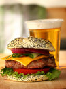 Burger and beer close up of big tasty Royalty Free Stock Photos