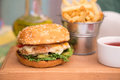 Burger with chicken cutlet and fries Royalty Free Stock Photo