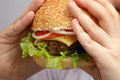 Burger in children hand Royalty Free Stock Photography