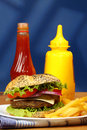 Burger close up of big tasty and french fries Royalty Free Stock Images