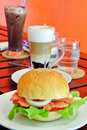Burger and coffee in breakfast on table Stock Images