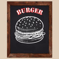 Burger drawn with chalk on a black background