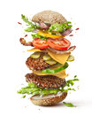 Burger with flying ingredients Royalty Free Stock Photo
