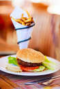 Burger and french fries close up of delicious fresh with cheese bacon Royalty Free Stock Photography