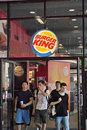 Burger king restaurant with some young customers walking out Royalty Free Stock Image