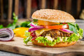 Burger made ​​from vegetables closeup of on old wooden table Royalty Free Stock Images