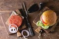 Burger and raw cutlet Royalty Free Stock Photo