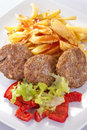 Burgers with fries salad and peppers Royalty Free Stock Images