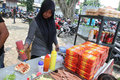 Burgers and hotdogs merchants selling in a city park in the city of solo central java indonesia Stock Photography