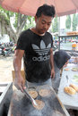 Burgers and hotdogs merchants selling in a city park in the city of solo central java indonesia Stock Photo