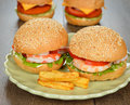Burgers with shrimp on a brown background Stock Photography