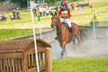 Burgie international horse trial competitor galloping through the water in the british eventing cross country held at on th june Stock Photos
