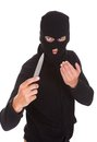 Burglar holding knife man in balaclava isolated on white background Stock Images