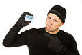 Burglar holding stolen credit card series with caucasian male as a or thief sneaking in a window carrying goods etc isolated on Royalty Free Stock Images