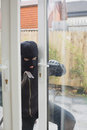 Burglar opening the terrace door with cro bar Royalty Free Stock Photography
