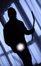 Burglar silhouette of with torch Royalty Free Stock Photography