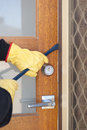 Burglar thief gloves holding crowbar breaking home unlock door copy space Stock Photography