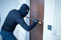 Burglar trying to force a door Royalty Free Stock Photo