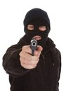 Burglar wearing mask holding gun aiming towards camera Royalty Free Stock Photo