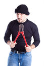Burglar with wire cutters a or a thief holding big Royalty Free Stock Photography