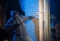 Burglar at work a is opening the backdoor of a house Royalty Free Stock Images