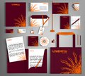 Burgundy corporate identity template design with an element of decorative orange flower