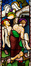 Burial of jesus christ stained glass window showing the Royalty Free Stock Photo