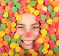 Buried on jellybeans little girl colored Royalty Free Stock Image