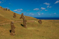 Buried moais view of several burried at rano raraku quarry on rapa nui Stock Photos