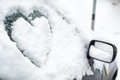 Buried by snow car with heart on side window Royalty Free Stock Photo