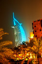 Burj Al Arab glowing at night in Cyan Royalty Free Stock Images