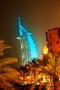 Burj Al Arab glowing at night in Cyan Royalty Free Stock Photo