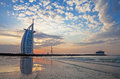 Burj al arab sunset jumeirah beach beautiful clouds and blue sky in warm golden light Royalty Free Stock Photography