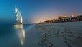 Burj Al Arab at sunset with luxury beach view