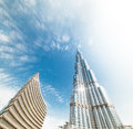 Burj khalifa vanishing in blue sky in dubai uae united arab emirates december it is tallest structure world since metres august Stock Photos