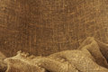 Burlap backgraund background of crumpled beige Stock Photos